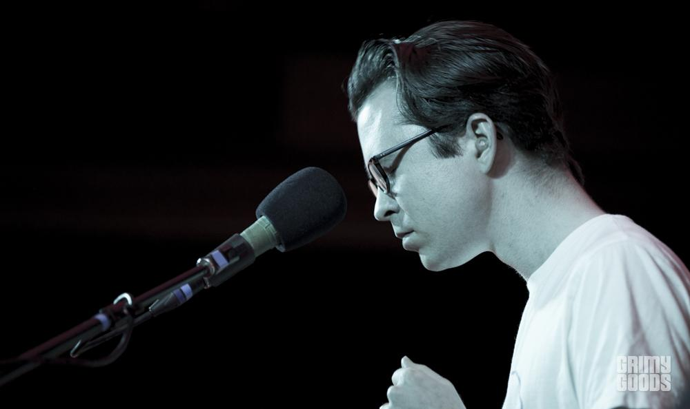 Tom Vek performing at the Natural History Museum in Los Angeles, California, photo by Wes Marsala