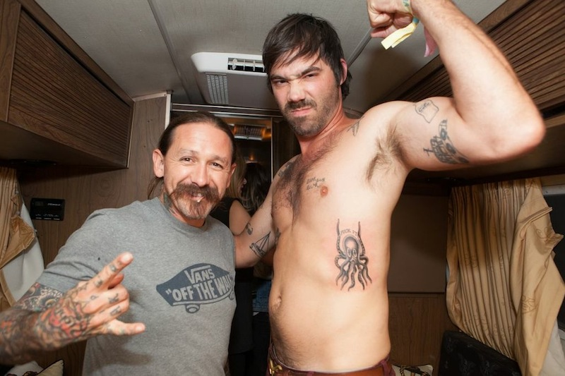 Sebastien Grainger of Death From Above 1979  getting an Oliver Peck tattoo at FYF FEST