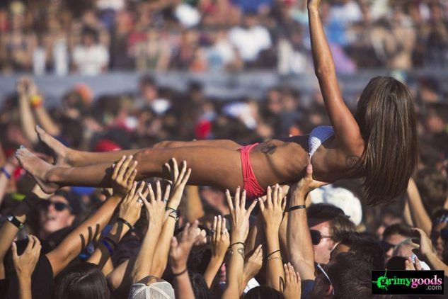 Concert crowd at the beach crowd surfing