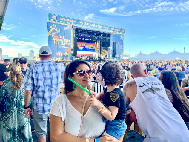 Sandra Burciaga Olinger at a music festival with her baby